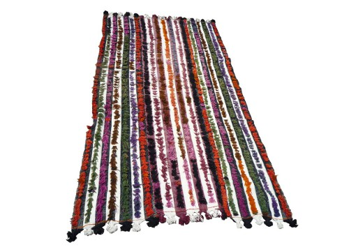 vintage multi colored tulu rug via rummage